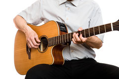 Man plays guitar. Man plays 6-strings acoustic guitar Royalty Free Stock Photo