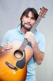Man plays the guitar Royalty Free Stock Photos