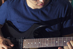 Man plays guitar Stock Image