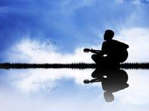 Man plays guitar. Illustration of man plays guitar on river Stock Image