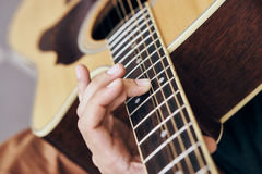Man plays the guitar, music, musical instruments, strings.  Stock Images