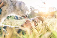 Man plays with his dog Stock Images