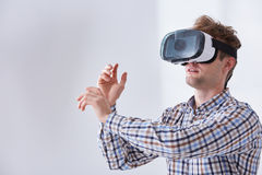 Man plays immersive game. Using innovative technologies in home Stock Images