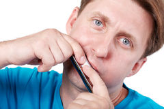 Man plays mouth harmonica Royalty Free Stock Photography