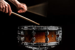Man plays musical percussion instrument with sticks a musical concept with the working drum Stock Photography