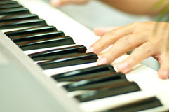 A man plays piano Royalty Free Stock Photo