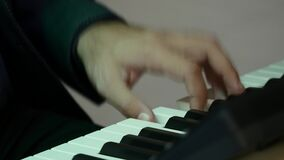 Man plays the piano chord.  stock video