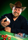 Man. plays poker Royalty Free Stock Image