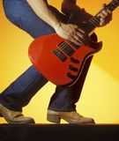 Man plays red guitar. A man plays red electric guitar Royalty Free Stock Photos