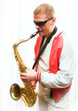 A man plays the saxophone Royalty Free Stock Images