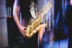 Man plays the saxophone close up. freezelight Stock Photo
