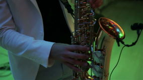 A man plays the saxophone. Man playing saxophone on concert,video full HD stock footage