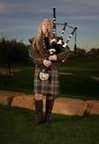 Man Plays Scottish Bagpipes at Dusk Stock Photography