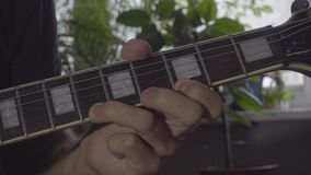 A man plays a solo on an electric guitar stock video