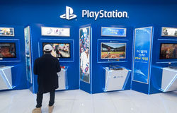 Man plays on Sony PlayStation 4. SEOUL - MARCH 29, 2017: A young man uses a PS4 at the Hyundai IPark shopping mall. PlayStation 4 PS4 is a line of home video Stock Images