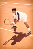 Man plays tennis. Male player at the clay tennis court Stock Photography