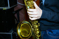 Man plays a tenor sax Royalty Free Stock Photo