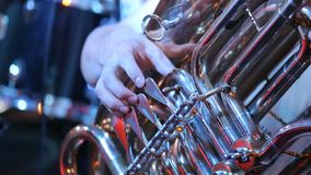 Man plays on the tuba melody on concert stock video