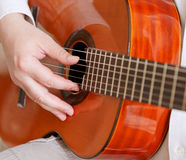 Man plays on typical acoustic guitar Royalty Free Stock Photo