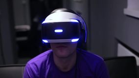 Man plays VR video game stock video