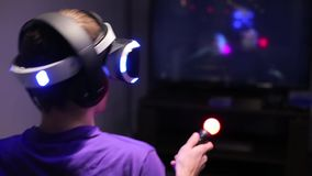 Man plays VR video game stock footage