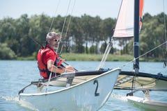 Man pleasure boating on lake Stock Photography