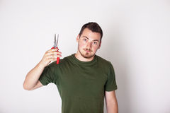 Man with pliers Stock Images