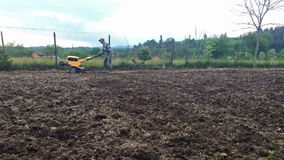 Man plowing with cultivator stock video