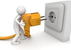 Man plugging AC power cord Stock Image