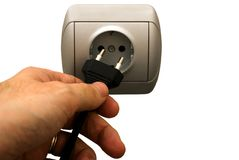 Man plugging wall socket Royalty Free Stock Photography