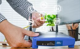 Man plugs internet cable into the router. router wireless wire broadband home concept