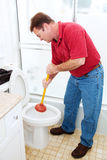 Man Plunging Toilet Royalty Free Stock Images