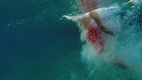 Man plunging in the water - underwater view. A Man plunging in the water - underwater view stock video footage