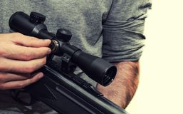 Man with pneumatic rifle royalty free stock images