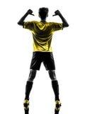 Man po för brasiliansk fotbollsspelare för fotboll för stående för bakre sikt ung Arkivbilder