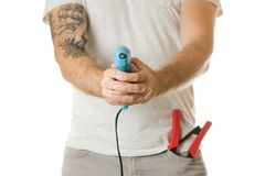 Man in a pocket constructing tools stock photography