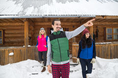 Man Point Finger People Group Near Wooden Country House Winter Snow Resort Cottage Stock Image