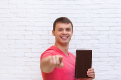 Man Point Finger At You Holding Tablet Computer Stand Over Wall Royalty Free Stock Photo
