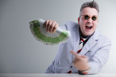 Man pointig banknotes in his hand Stock Image