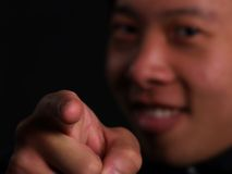 A man pointing. An Asian man pointing his finger to you Royalty Free Stock Images