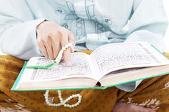 Man pointing at al-quran Stock Photo