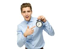 Man pointing at alarm clock Stock Images