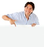 Man pointing at a banner Stock Photography