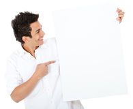 Man pointing at a banner Stock Images