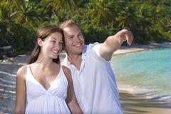 Man pointing on beach Royalty Free Stock Photo