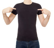 Man pointing at black t-shirt Royalty Free Stock Photos