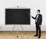 Man pointing on blackboard Royalty Free Stock Images