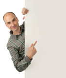 Man pointing at a blank board. Handsome man pointing at a blank board Stock Image