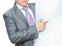 Man pointing at blank board Stock Photo