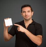 Man pointing at a blank card Royalty Free Stock Images